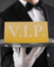 Close-up Of Waiter Showing Vip Text On B