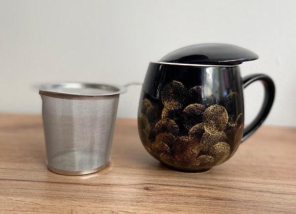 Thee tas zwart/goud met vergietje en deksel