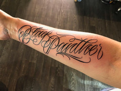 black panther tattoo lettering