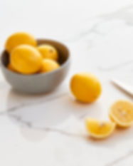 Lemon on White Marble Countertop in Manh