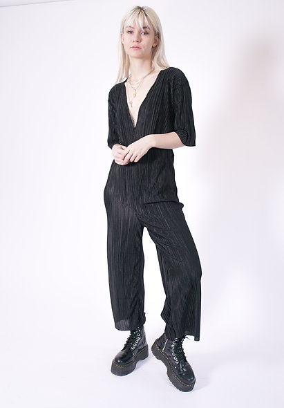 Wide leg plisse jumpsuit with deep plunge