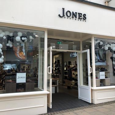 Jones Bootmaker's black and white window display