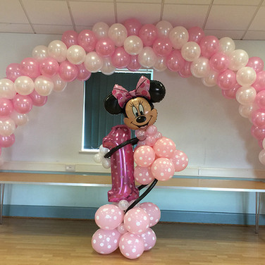 Spiral arch for a 1st Birthday with a bespoke Minnie Mouse display