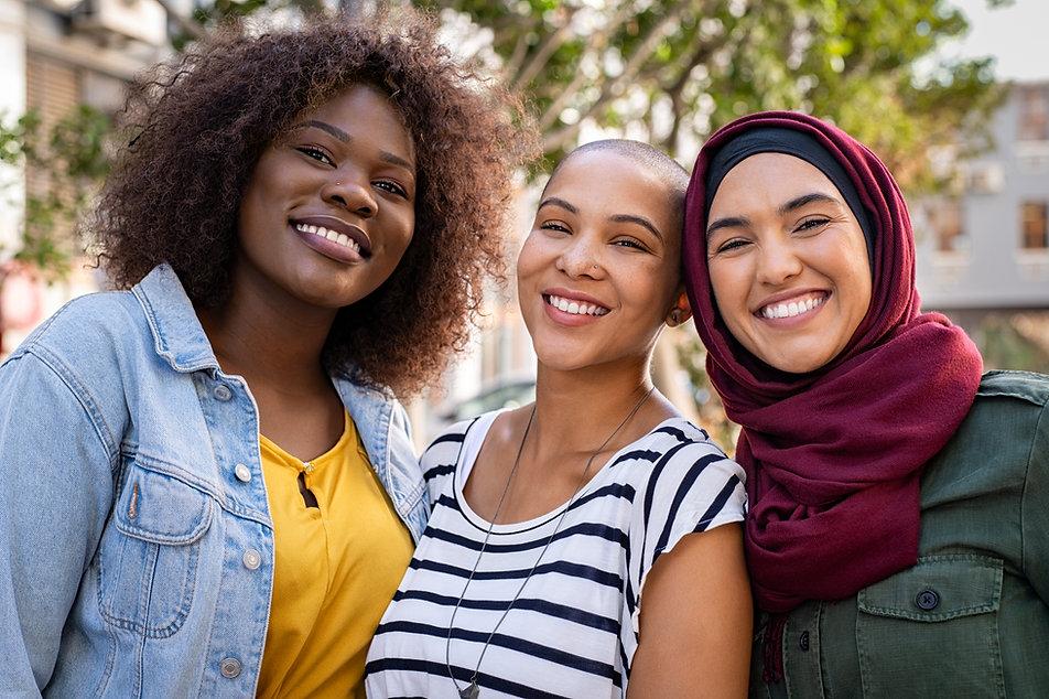 Group of three happy multiethnic friends