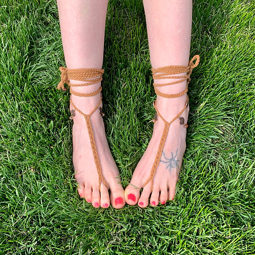 Brown organic vegan cotton with glass crystal beads & bronze metal barefoot sandals foot jewelry on feet in grass front view