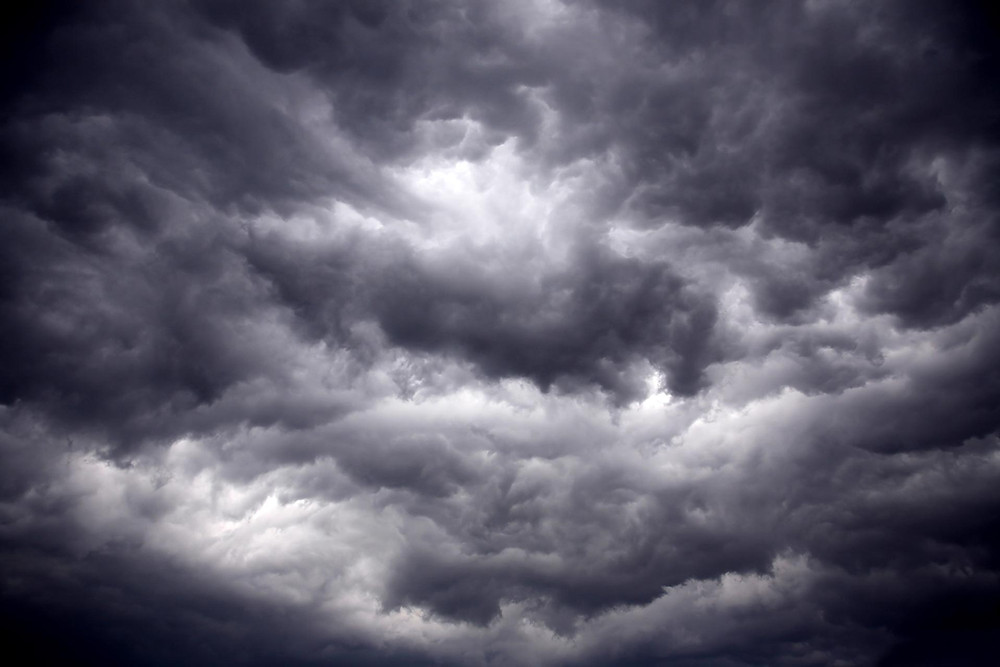 Dark gray storm clouds in sky