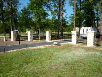 Custom Stone and Iron Fencing