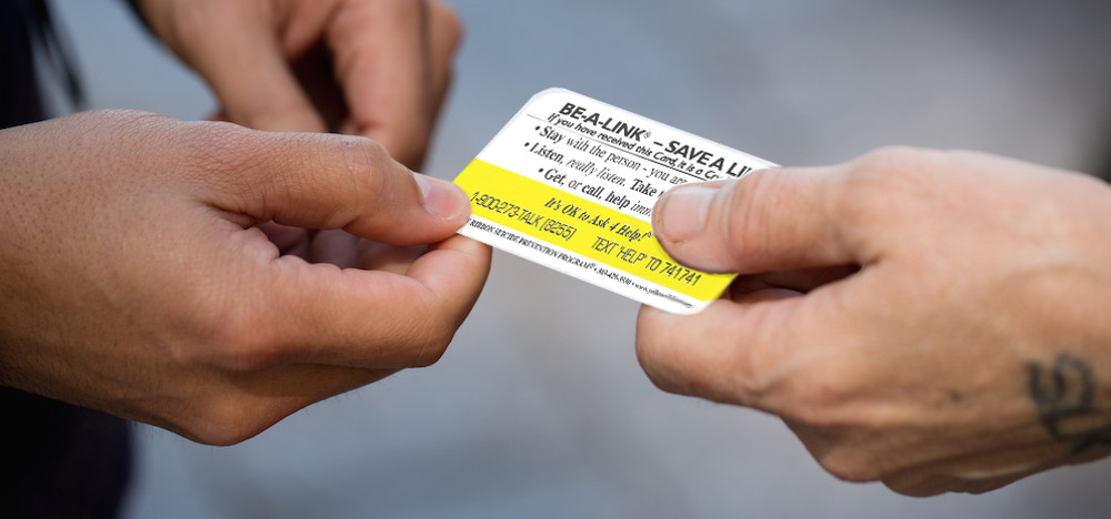 Created an image showing the action of one of their Help Cards being handed to someone.