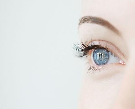 Blue open eye gazing in the distance.