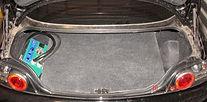 Mazda battery trunk