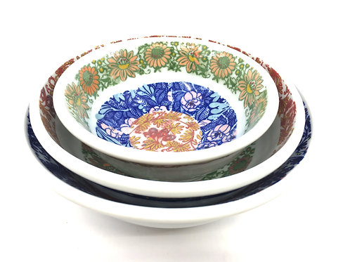 A Set of Three Nesting Bowls with Hand Painted Decal Floral Patterns