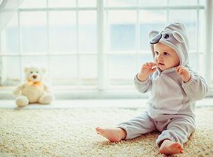 beautiful-little-boy-sitting-by-window_1