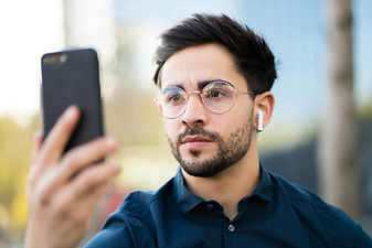 young-man-using-face-id-for-unlock-mobil