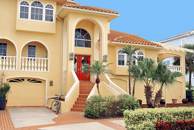 beautiful stucco house, repair water damaged stucco, stucco water damage causes, how to fix stucco, signs of water damage in stucco