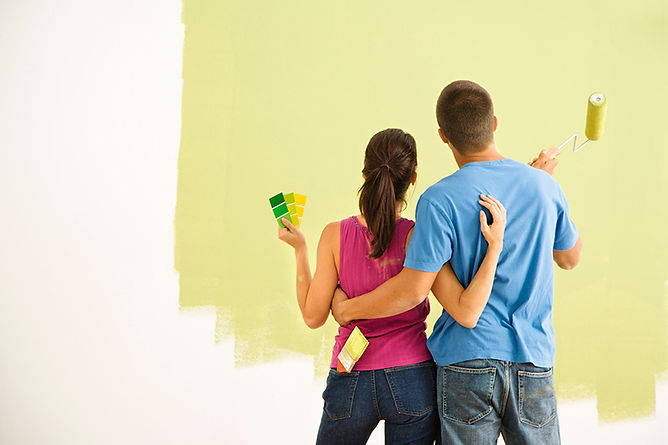 Things Every Homeowner Should Know Couple Painting Wall