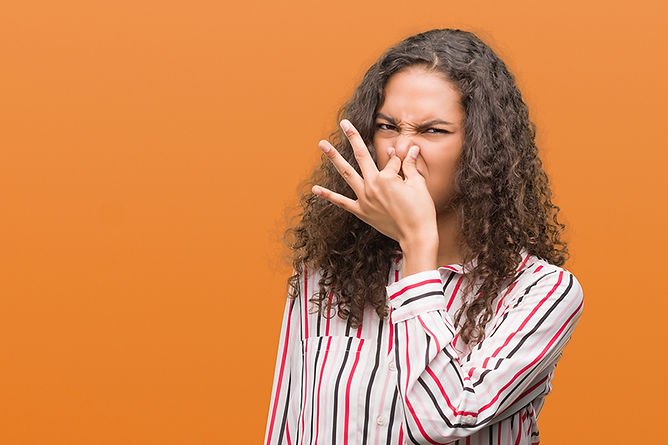 woman plugging nose, water damage myths, water damage mitigation mistakes, what not to do when you have water damage, how to handle water damage