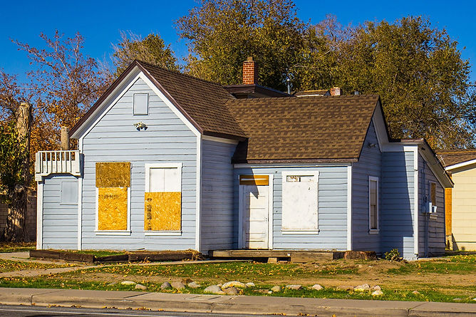 house with boarded windows, water damage build back and reconstruction, fire damage reconstruction, water damage restoration, fire damage restoration, professional damage restoration