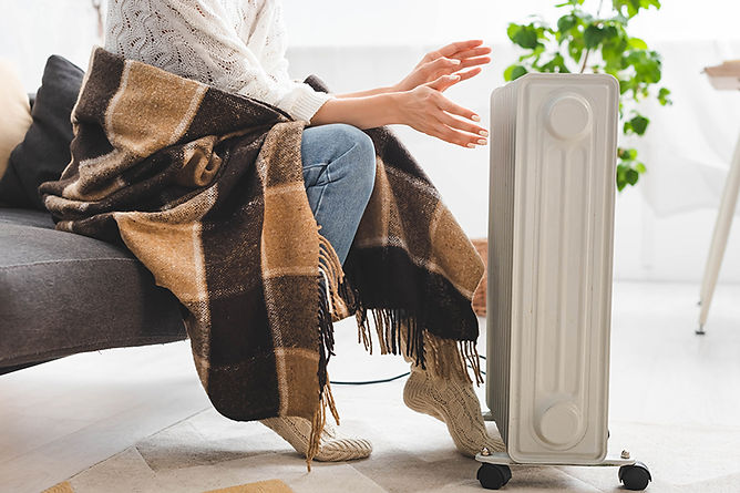 woman next to space heater, what to do after a house fire, common causes of house fires, steps after a house fire, how to recover from a house fire