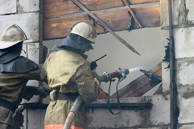 firefighters putting out fire, buying a fire damaged home, pros and cons of buying a fire damaged property, buy a house with fire damage, Buy a house with smoke damage