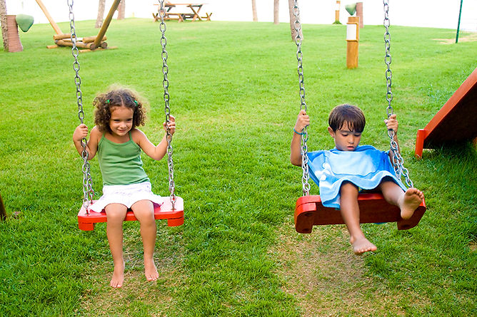 Backyard Safety Tips Kids Swinging, backyard safety tips, keep your backyard safe, summer safety, pool safety, grill safety, backyard party safety