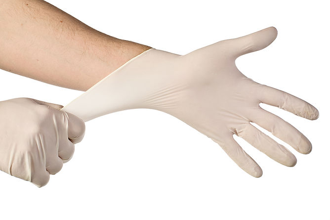 Employee Positive For COVID 19 Putting On Gloves