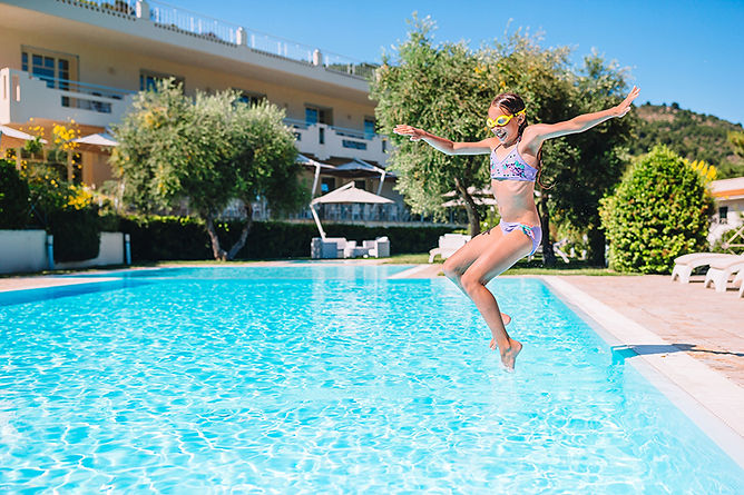 Backyard Safety Tips Kid Jumping Into Pool, backyard safety tips, keep your backyard safe, summer safety, pool safety, grill safety, backyard party safety