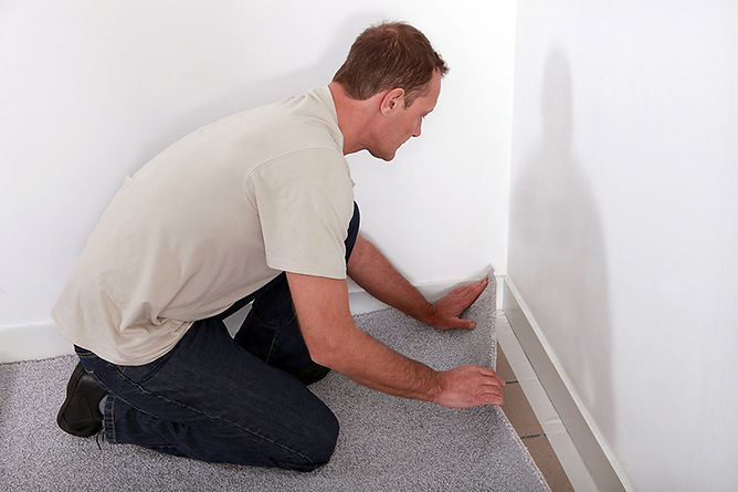 man removing carpet, water damage myths, water damage mitigation mistakes, what not to do when you have water damage, how to handle water damage