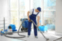 Home Reconstruction After Water Damage Man using industrial vacuum