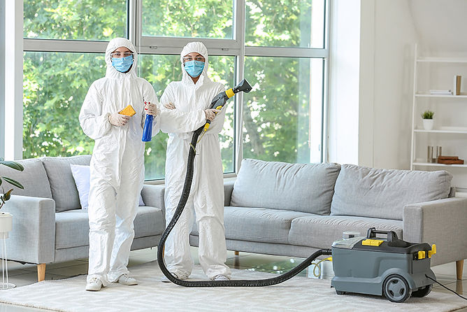 hazmat men posing,  biohazard cleanup after a death, how to clean a property after a death, death in a rental property, crime scene cleanup
