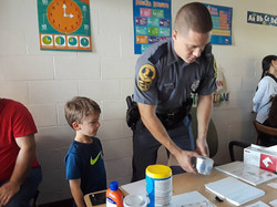 Police officer teaching about safety