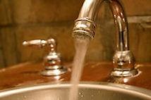 Plumbing faucet running water