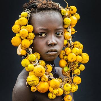 Mursi Boy wearing yellow adornment