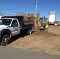 Shovel loading an IDEAL landscaper truck in Sault Ste. Marie