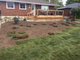 Sod being laid on a front yard