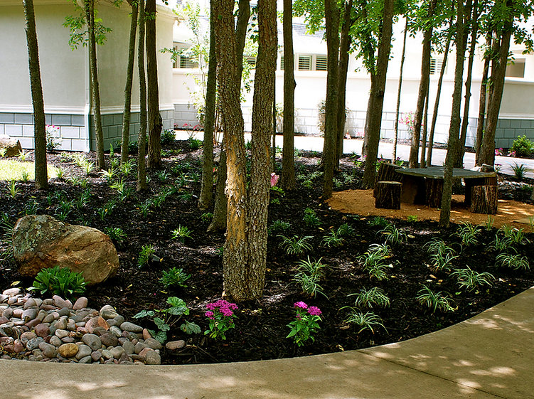 With Flagstone Stair Walkway, Entry Columns, Pottery Accents And A Vertical Garden  On The Wall.