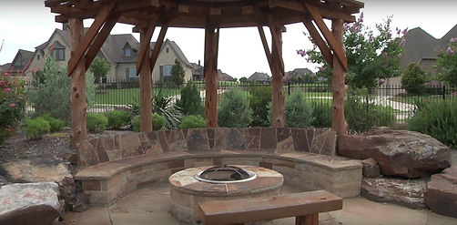 Natural Cedar Post Pergola, Stone Bench and Fire Pit