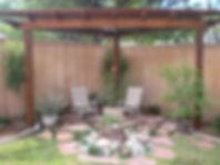Custom Cedar Pergola, Flagstone and Rock Water Feature