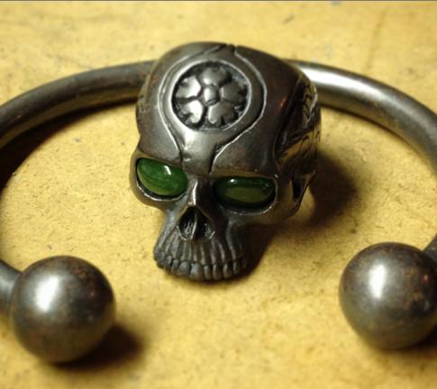 silver skull ring and bracelet