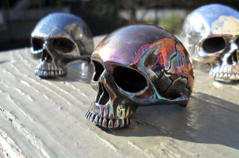 custom silver skull rings with various finishes.