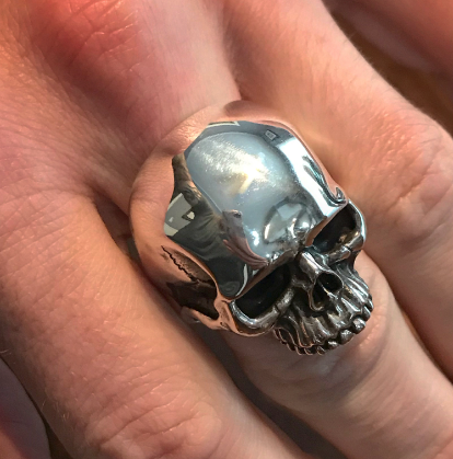 Skull ring on finger