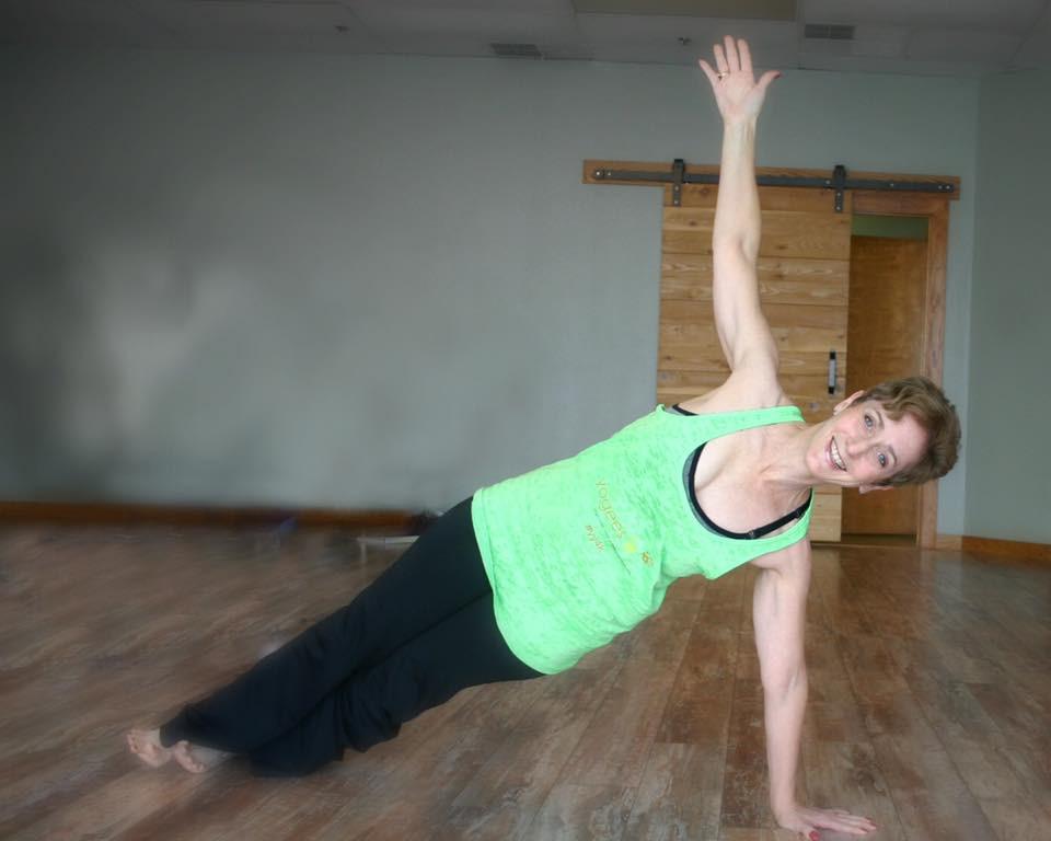 Phyllis Smith doing side plank Yoga pose