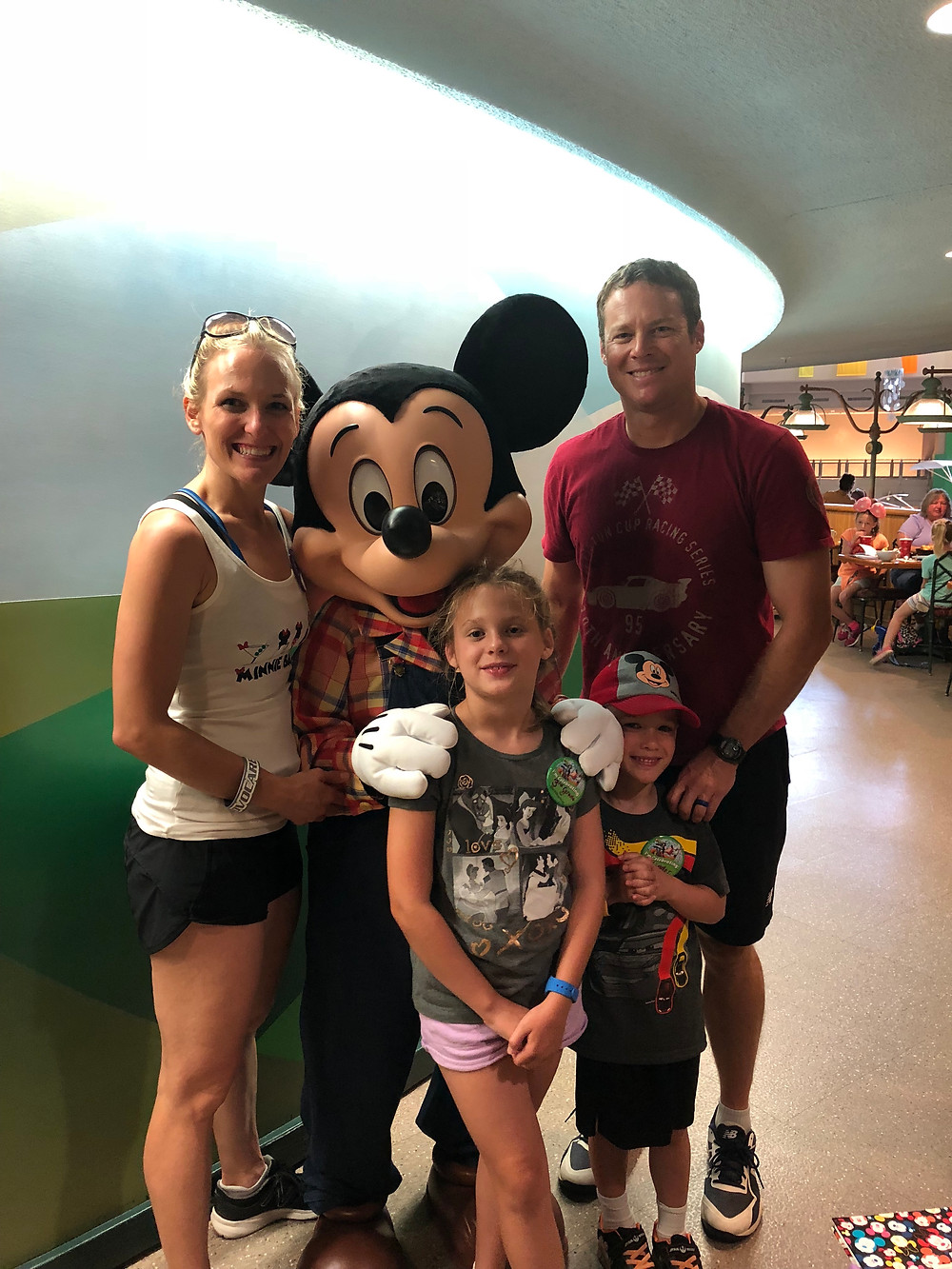 family together with Mickey Mouse at Disney World