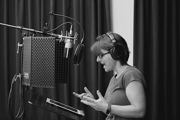 Rachel Simon doing voice over work in a recording studio