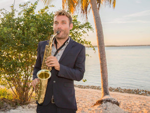 La Barcaza, Wedding Party Boat-               Sax music at the beach ceremony!