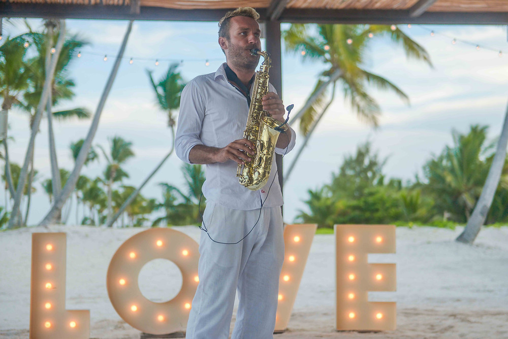 Palapa Juanillo wedding musician at the cocktail hour with LOVE, Sax/DJ