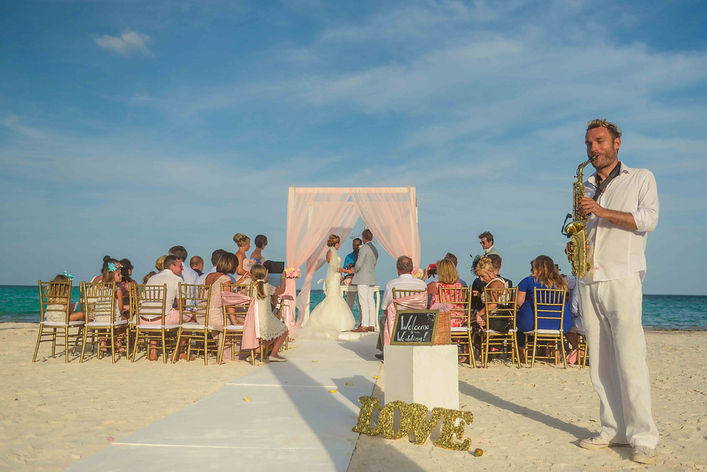 Wedding music at Palapa Juanillo, Cap Cana. Saxophone player at the beach ceremony
