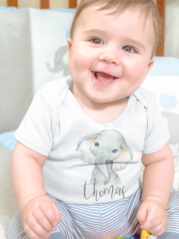 mockup-of-a-smiling-baby-boy-sitting-in-
