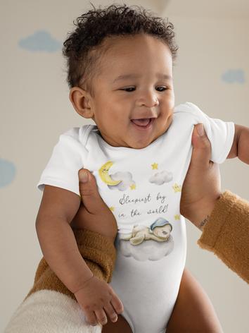 onesie-mockup-of-a-joyful-baby-being-lif