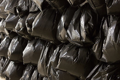 Wasteline - How much does a coventional trash bag weigh?