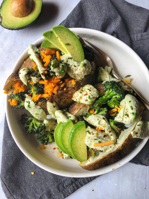 "LOADED BAKED POTATO WITH CALIFORNIA AVOCADO ""SOUR CREAM"", BROCCOLI & CHEDDAR CHEEZE (S"